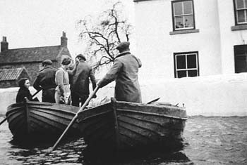 The road outside Jim Pool's farm, West Haddlesey. Barbara Pool is the young woman sitting in the boat